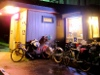 bicycles in front of iluminated storefront