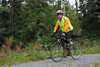 cyclist on wooded bike trail
